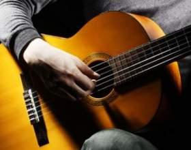 Як навчитися грати боєм на гітарі? фото